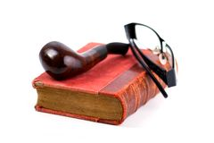 Old Folio. In dark red cover, pipe and black-rimmed glasses on white background. Book with ancient knowledge Stock Image