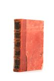 Old Folio. In dark red cover on white background. Book with ancient knowledge Royalty Free Stock Photo