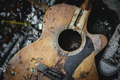 Old folk guitar broken. Old folk guitar with a broken hole Royalty Free Stock Images