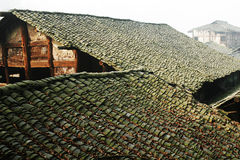 Old folk house. With tile roof in morning sunlight royalty free stock image