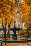 Old fontain in fall stock images