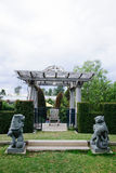 Old Foo Dog and alcove  in the City Garden Royalty Free Stock Photos