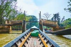 The old foot bridge on Inle Lake, Myanmar stock photo