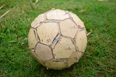 Old footbal. L on green grass ground Royalty Free Stock Images