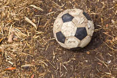 An old football. A left old football on the ground Stock Image