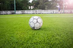 Old football on Artificial turf football field green Royalty Free Stock Photography