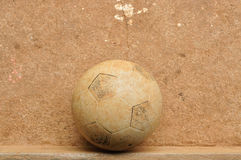 Old football on cement floor. Old football on grunge cement floor Royalty Free Stock Image