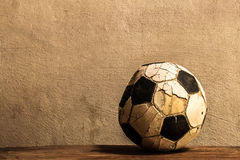 Old football. On concrete background Stock Photography