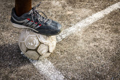 Old Football On Concrete Field Stock Photography
