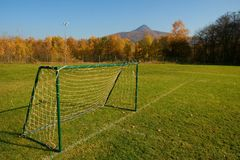 Old Football Gate On Village  Football Field. Sunny day at the end of season, poor grass Stock Photos