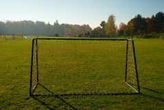 Old Football Gate On Village  Football Field. Sunny day at the end of season, poor grass Stock Image