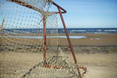 Old football goal on the beach stock images