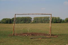 Old football goal for mini football on trampled lawn in forest zone. stock image