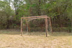 The old football goal under sunlight Stock Images