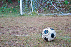 The old football on the grass Royalty Free Stock Images
