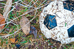 The old football on the grass Royalty Free Stock Photos