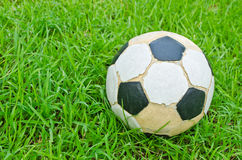 Old football on green grass Royalty Free Stock Photo