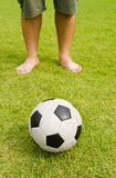 Old football on green grass Royalty Free Stock Photos