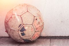 Old football m`yach standing on the ground, street football stock photos
