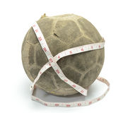 Old football with measuring tape Stock Photo
