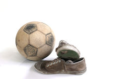 Old football and old shoes isolated. Old football and old shoes Royalty Free Stock Photos