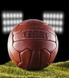 Old football over green grass Stock Photos