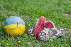 Old football shoes Royalty Free Stock Images