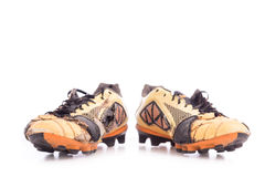 Old football shoes on white