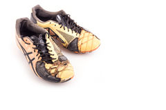 Old football shoes  on white Stock Image