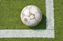Old football or soccer ball on the grass Stock Photos