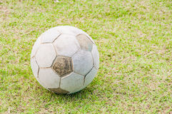Old football, soccer ball on the grass Royalty Free Stock Photos