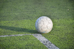 Old football, soccer ball on the grass Stock Images