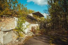Old football stadium in Chornobyl exclusion zone. Radioactive zone in Pripyat city - abandoned ghost town. Chernobyl royalty free stock photos
