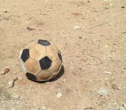 Old football. Useless football on ground Royalty Free Stock Photos