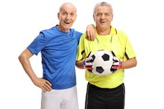 Old footballer with an old goalkeeper Royalty Free Stock Images