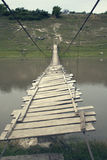 Old footbridge. Very old and dangerous footbridge royalty free stock photography