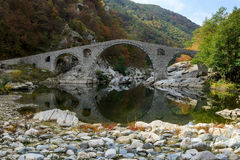 Old footbridge. Devil bridge landmark in Rhodopes mountain, Bulgaria Stock Photo