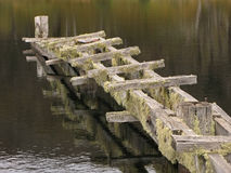 Old footbridge on lake Royalty Free Stock Images