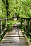 Old footbridge over a creek near Governor Bond Lake in rural Illinois stock photos