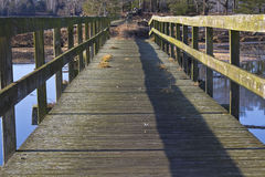 Old footbridge over water Stock Photography