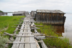 Old footway to abandoned slip docs. The picture shows abandoned and broken slip docs in a small settlement in Russia's Karelia region stock photos