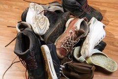 Old footwear. Big heap dirty old footwear Royalty Free Stock Photo