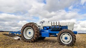 Old ford burton 148 tractor ploughing. The Burton 148 is a custom built tractor based on a Ford 5000 fitted with a Selene front axle conversion and Perkins V8 Stock Photo