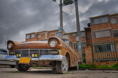 Old Ford car left alone in Tunja, Colombia.  stock photo