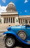 Old Ford in front of the Capitol  in Havana. Cubans keep thousands of classic cars like this running despite their age and they've become an world known icon of Stock Image