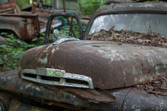 Old Ford in junk yard Stock Images