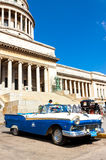 Old Ford parked at the  Havana Capitol. Vintage Ford parked in front of the Capitol in Havana.These old cars,the only ones that could be bought until a recent Royalty Free Stock Image