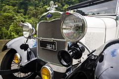Old Ford 1928. Santos, Brazil. April 14, 2018. Detail of the front of an old Ford 1928 stopped on the road between Santos and Sao Paulo Royalty Free Stock Photo