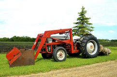 Old Ford tractor with a front end loader Stock Image