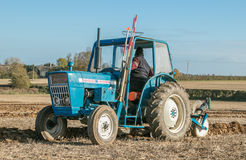 Old ford 3000 tractor ploughing. Old vintage blue ford 3000 tractor ploughing in english ploughing match Stock Photos